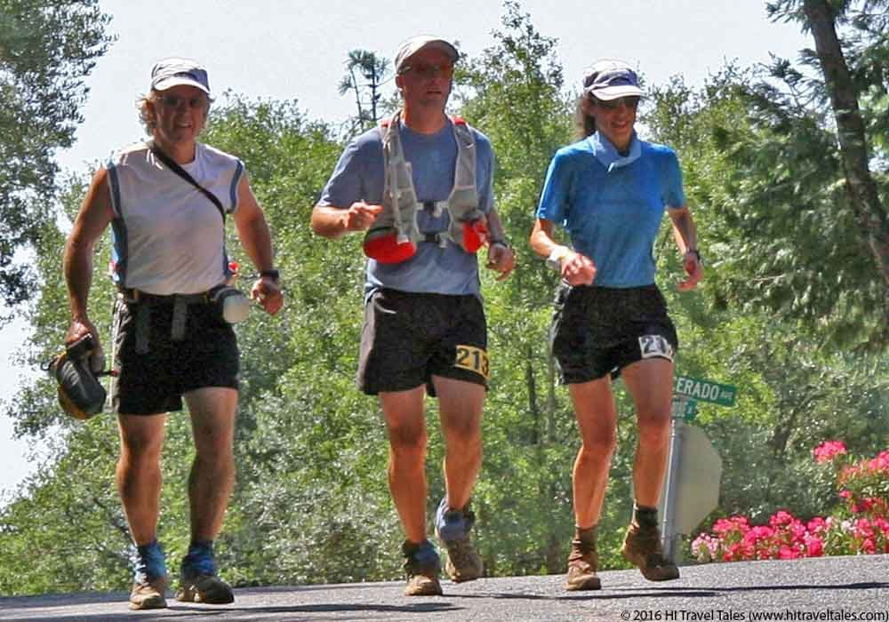 Therese nearing the finish line of the Western States 100 with her pacers Michael and Steve.