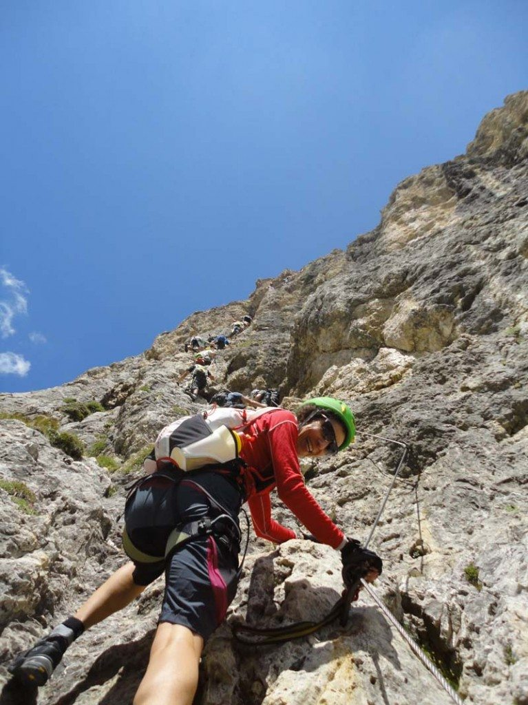 Author Therese Iknoian, high on the Via Ferrata Tridentina in the Dolomites.