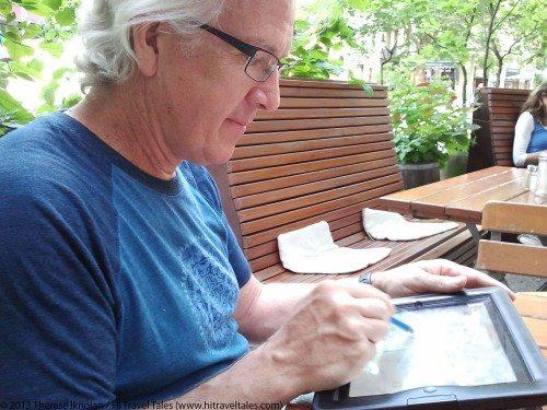 Michael Hodgson artist painting on his iPad