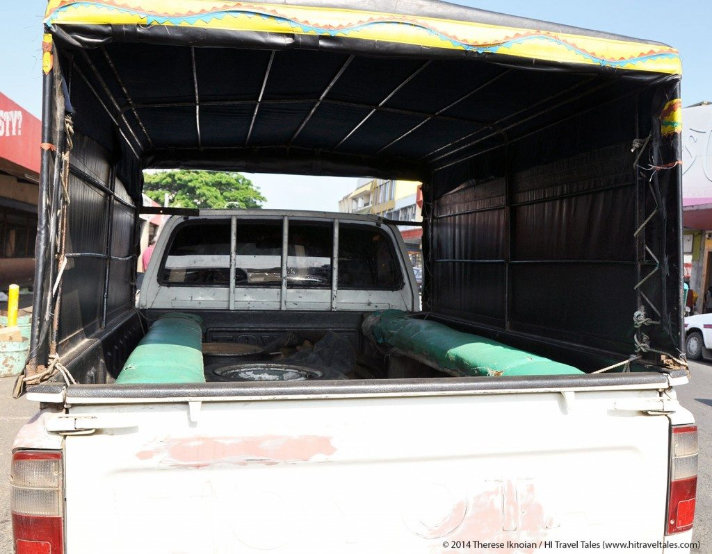 Fiji taxi to Koroyanitu. Two upholstered picnic benches are perched, not secured, on either side of a metal truck bed which you will share with several spare tires in various states of disrepair ... a view inside of Riaz's Toyota chariot.