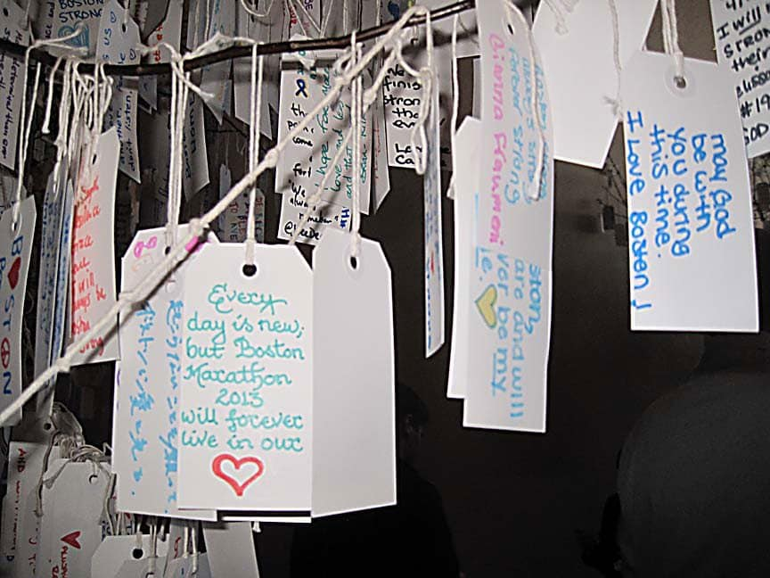 "Visitors to the Dear Boston exhibit wrote their thoughts on these tags and hung them on ""trees""...you could literally spend hours reading every one."