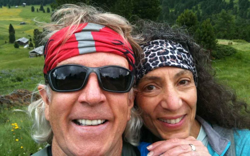 Michael and Therese wearing Buffs in the Dolomites