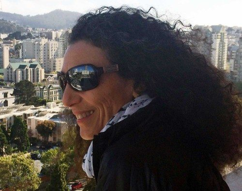 Therese Iknoian wearing the Switch sunglasses looking over the city of San Francisco.