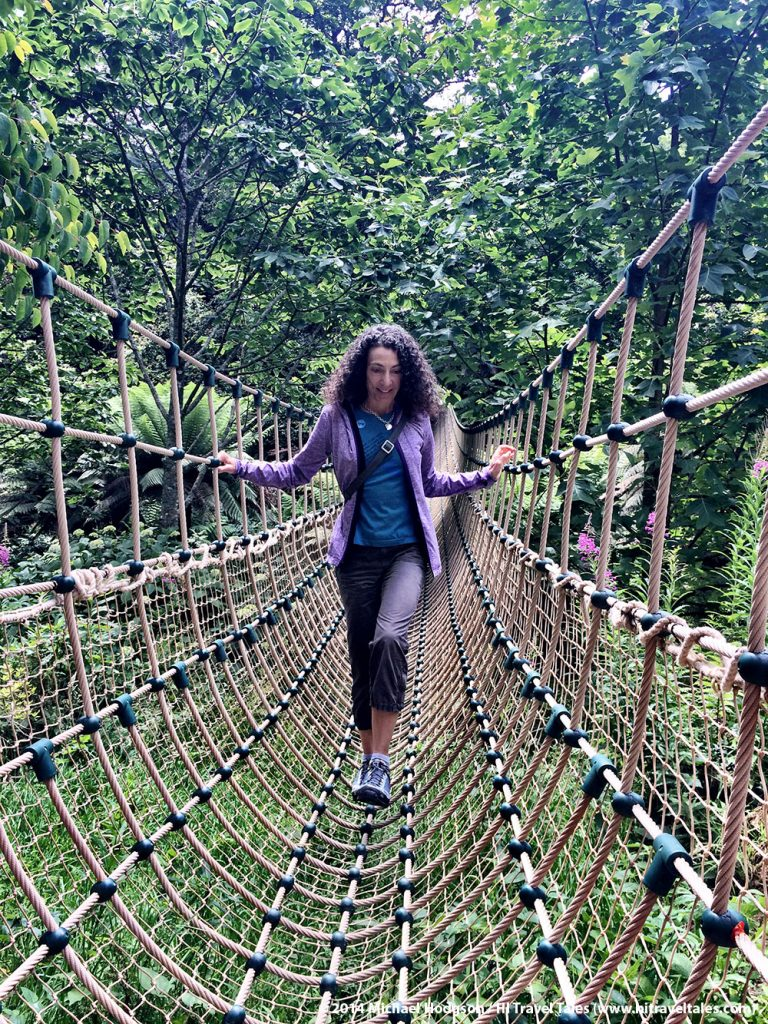 Therese waling across the Lost Gardens of Heligan famous rope bridge.
