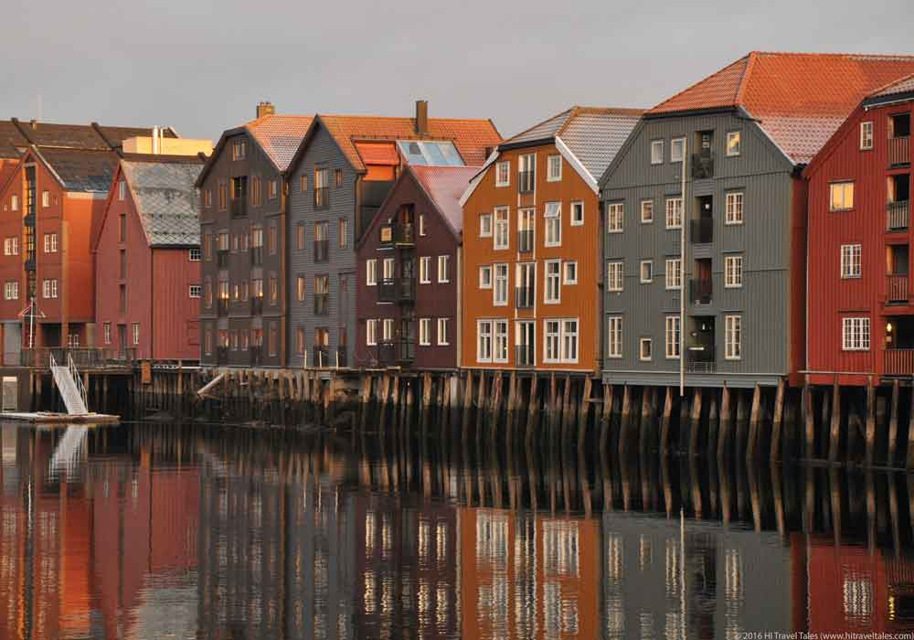 On a visit to Trondheim enjoy the magical colors of the wharf buildings along the Nidelva River near the Old Town Bridge.