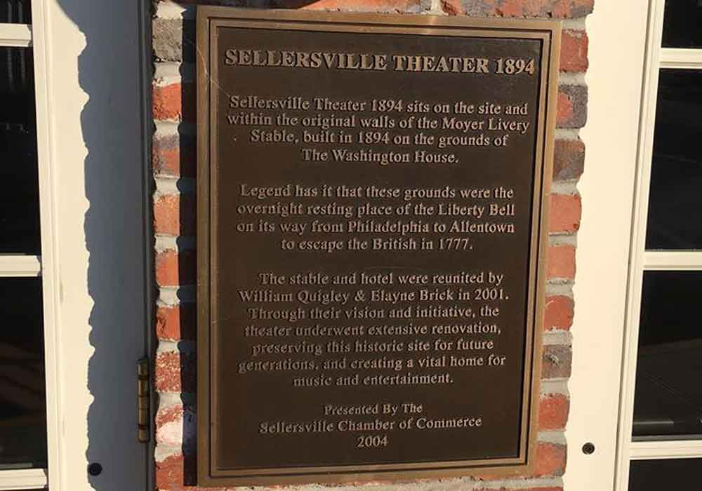 Diner tour looking at the Sellersville Theater plaque.