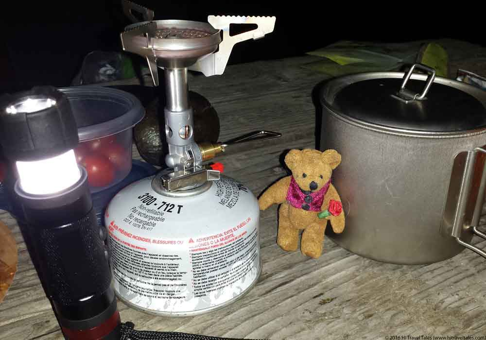 Nite Ize 3 in 1 Mini Travel Flashlight and Tiny Scruffles, our traveling bear at dinner