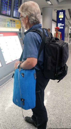 Pacsafe Travelsafe X15 being carried as a shoulder bag through the airport.