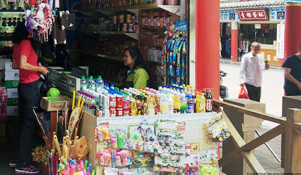 Therese spending money in China at a store in Kunming.