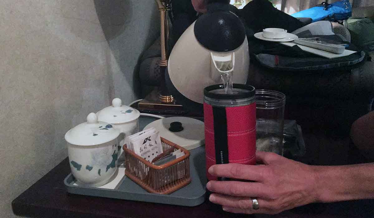 Pouring hot water into the GSI Commuter Javapress travel coffee mug