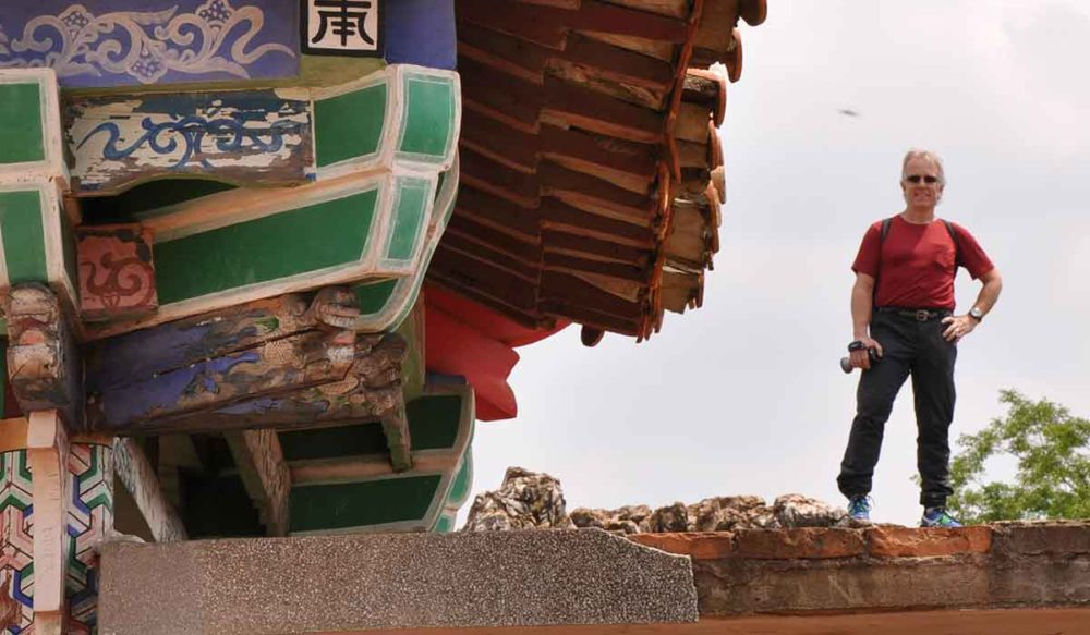 Standing by a pagoda in my Rab MeCo 120 layback tee on a trip to China.