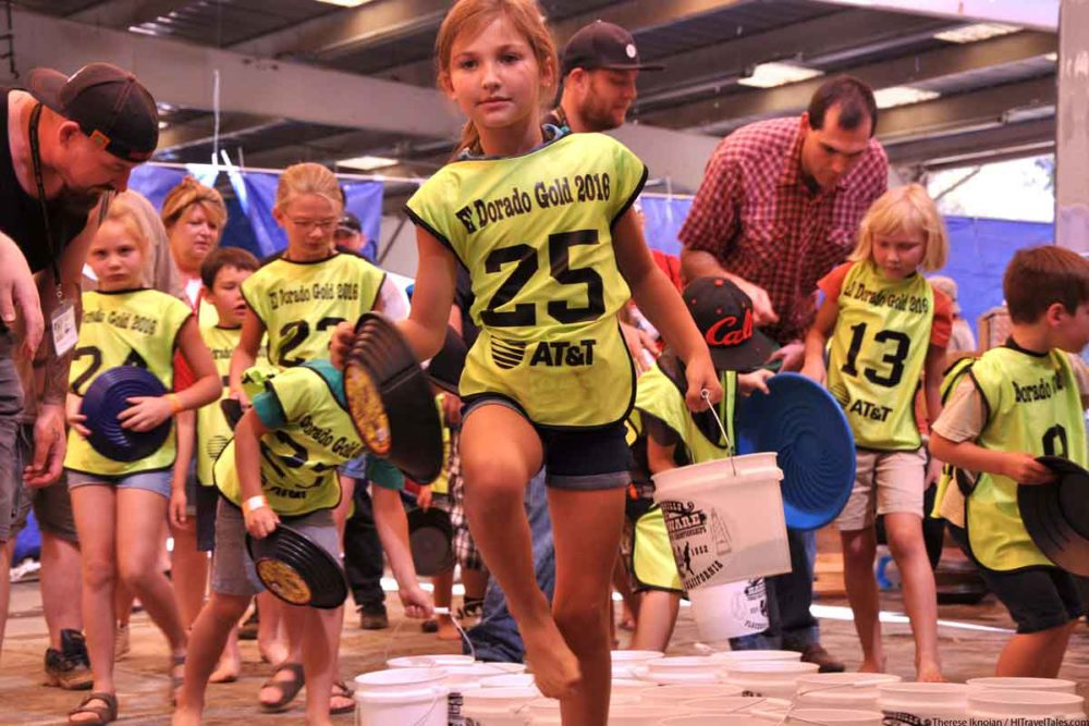 Kids running for their buckets at the World Championships for Gold Panning