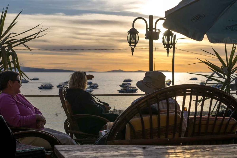 Guests in Cococabana, lingering over drinks while watching the sunset.