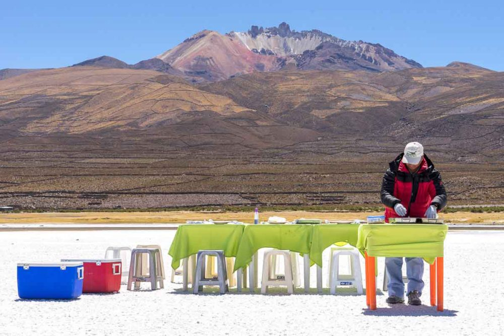 The guide prepares lunch on the salt flats.