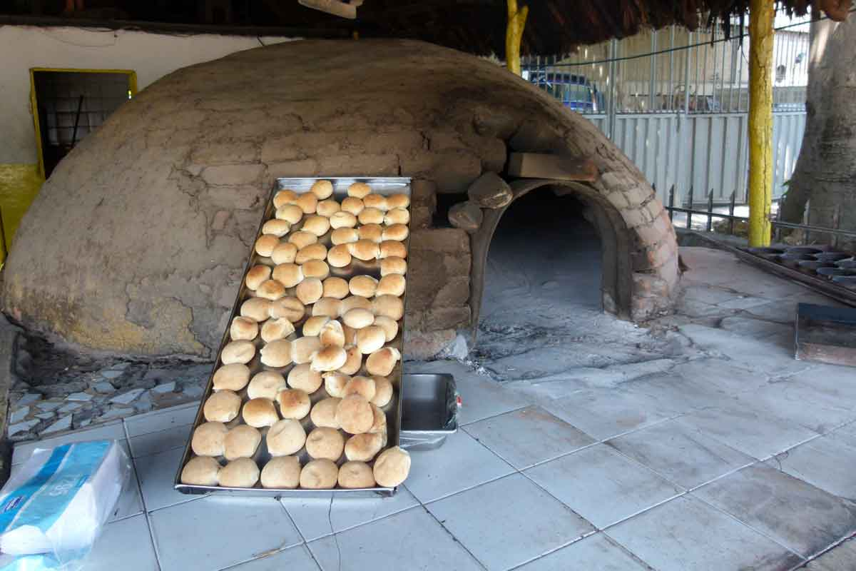 Bread baking in huge ovens in Colombia.