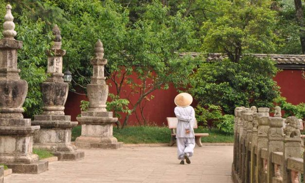 Monk on a walk at Huating Temple, Kunming, China