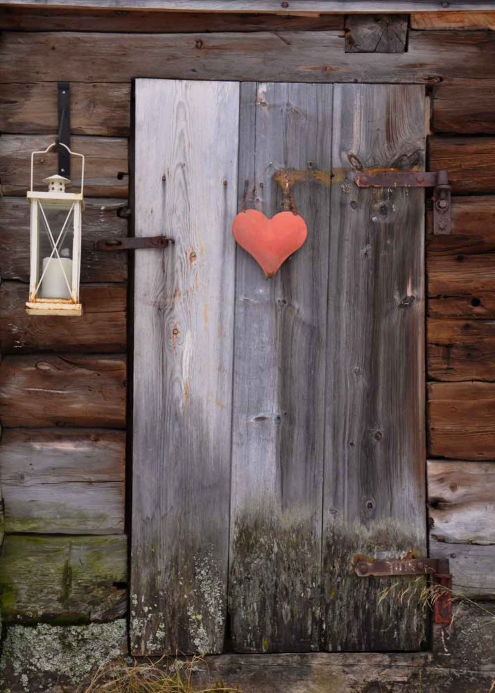 Roros Norway history town photo of a door with heart.