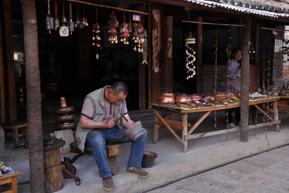 Baisha Village craftsman working on a pot.