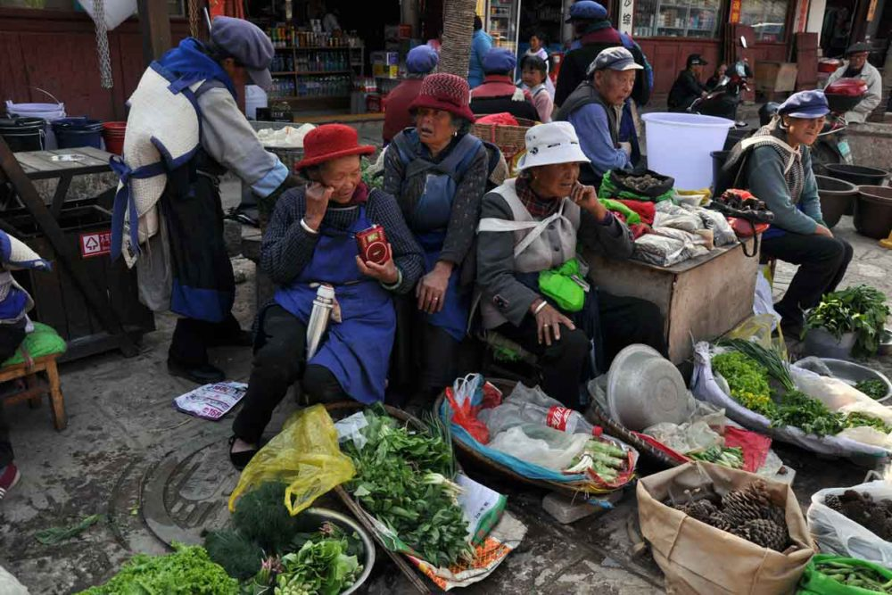 Baisha women selling local produce.