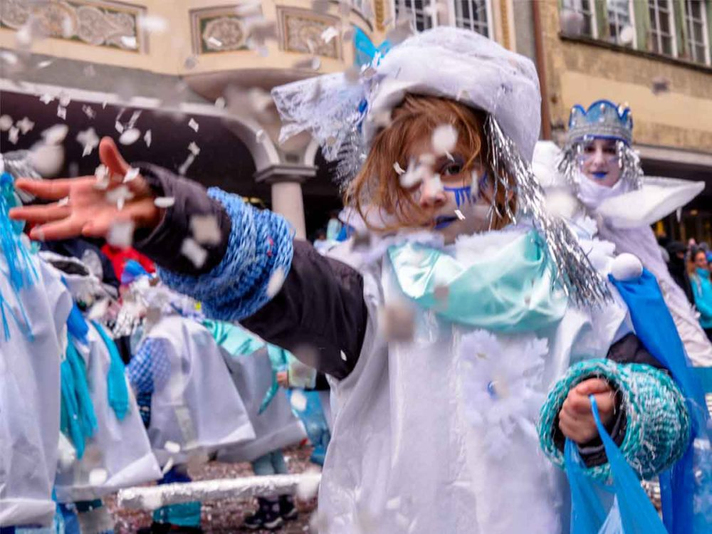 Girl throwing confetti at Swiss Carnival.