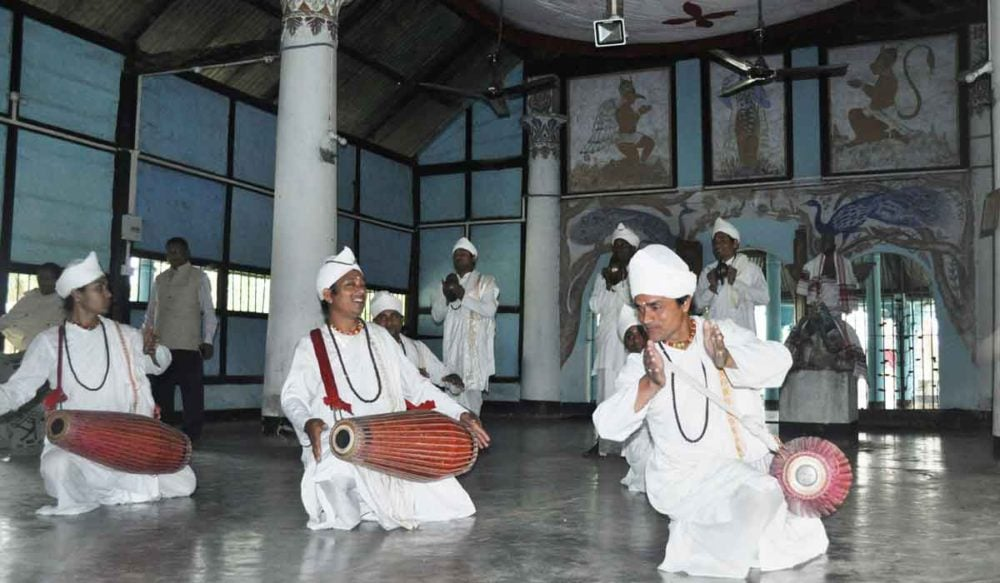 Monks perform a drum dance in India.