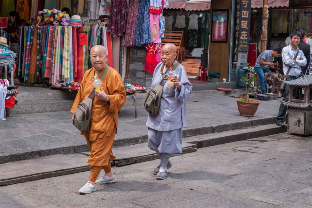 Two monks shopping in Dali Old Town.