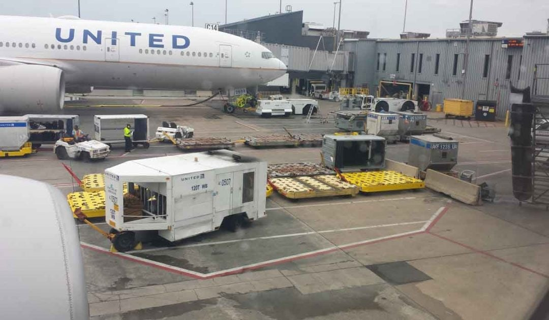 United Airlines plane getting loaded with luggage.