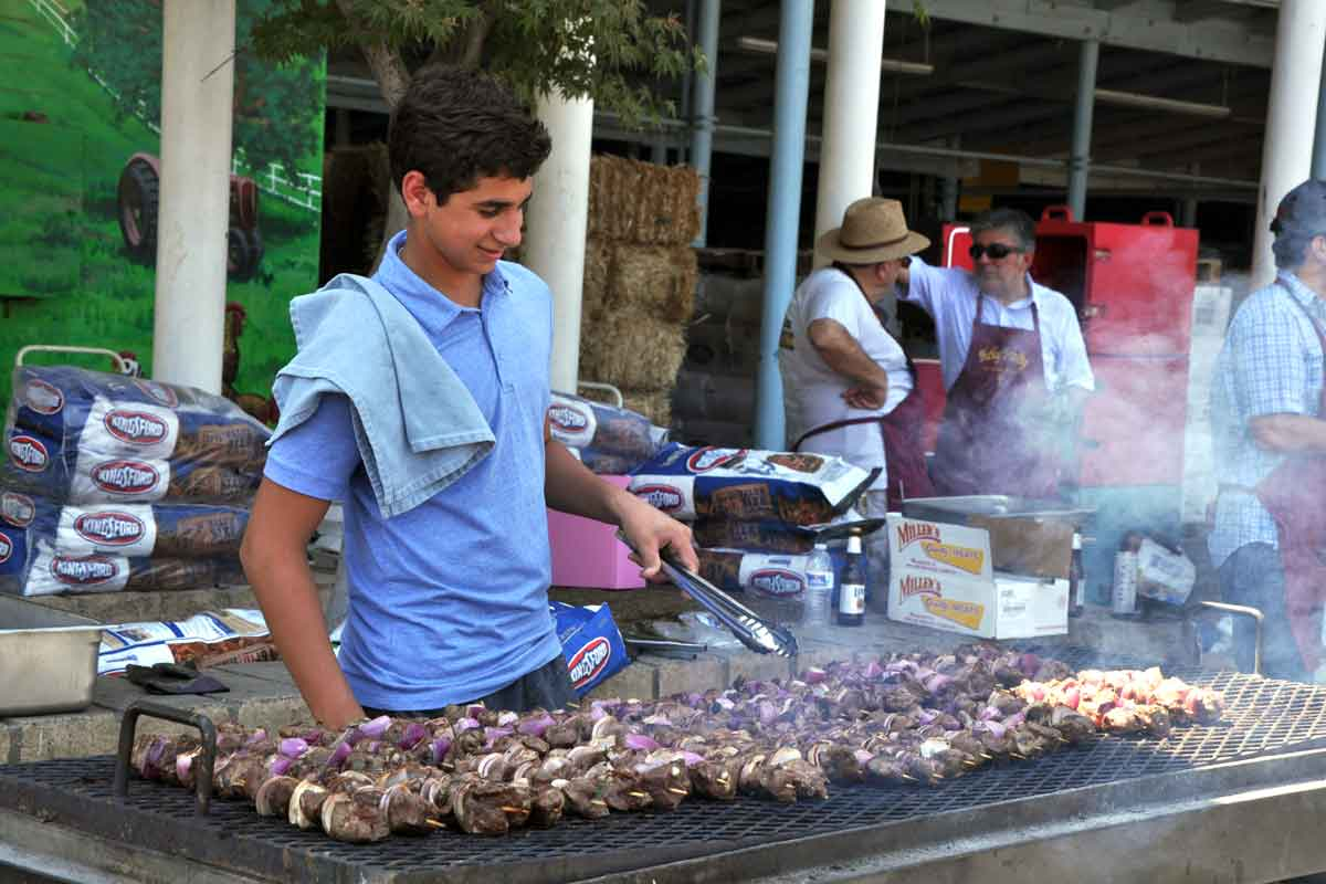 Grilling endless Shish Kebab skewers for attendees' lunches.