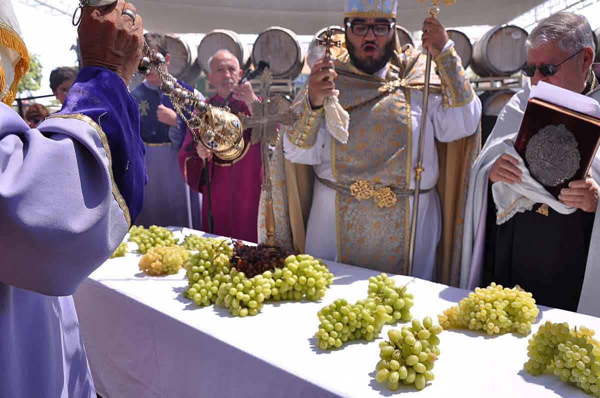 The Der Hayr, or highest priest, blesses the grapes.