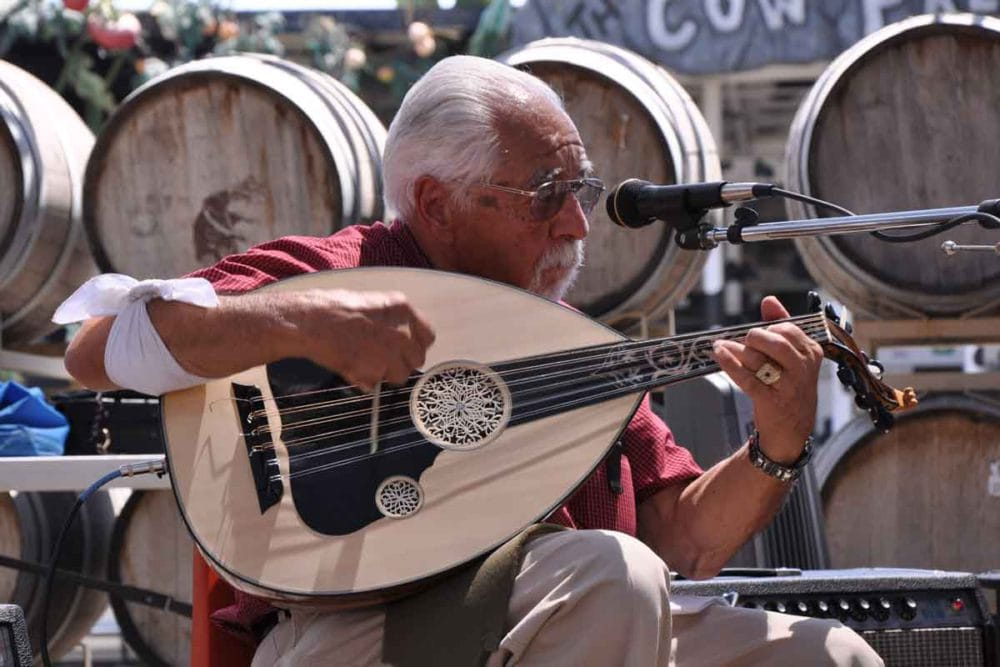 Richard Hagopian playing the oud at the blessing of the grapes ceremony.