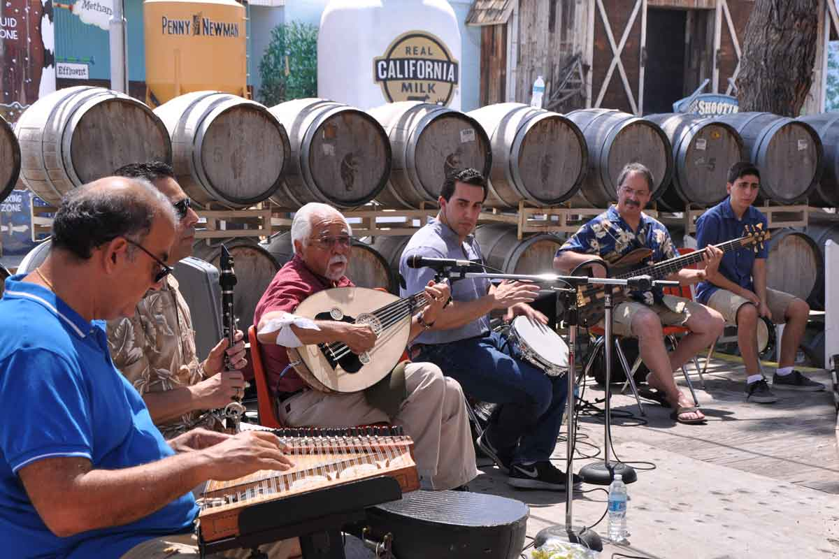 "Richard Hagopian (red shirt) and his ""oud"" supply dance music."