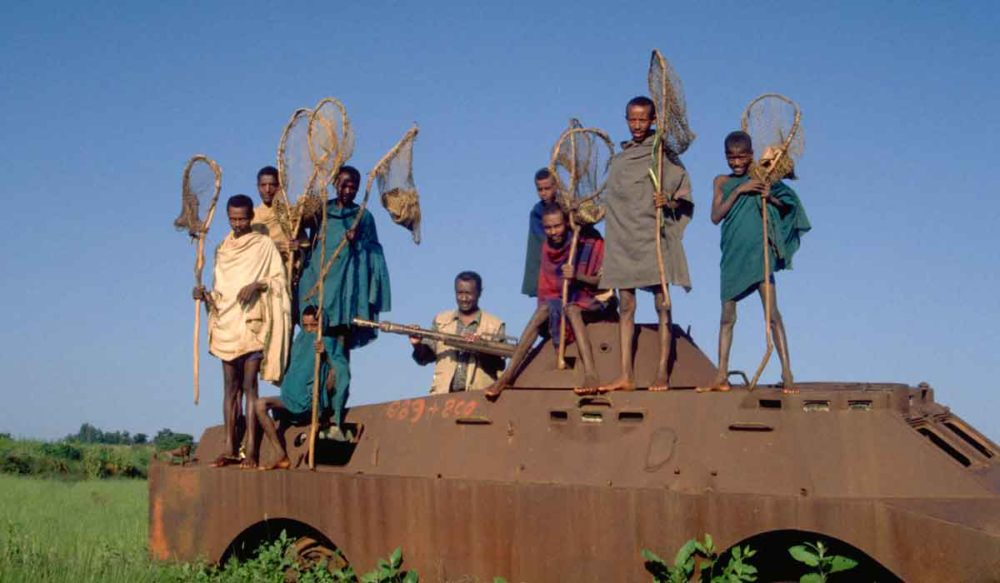 Fishermen on abandoned tank near Gondar.