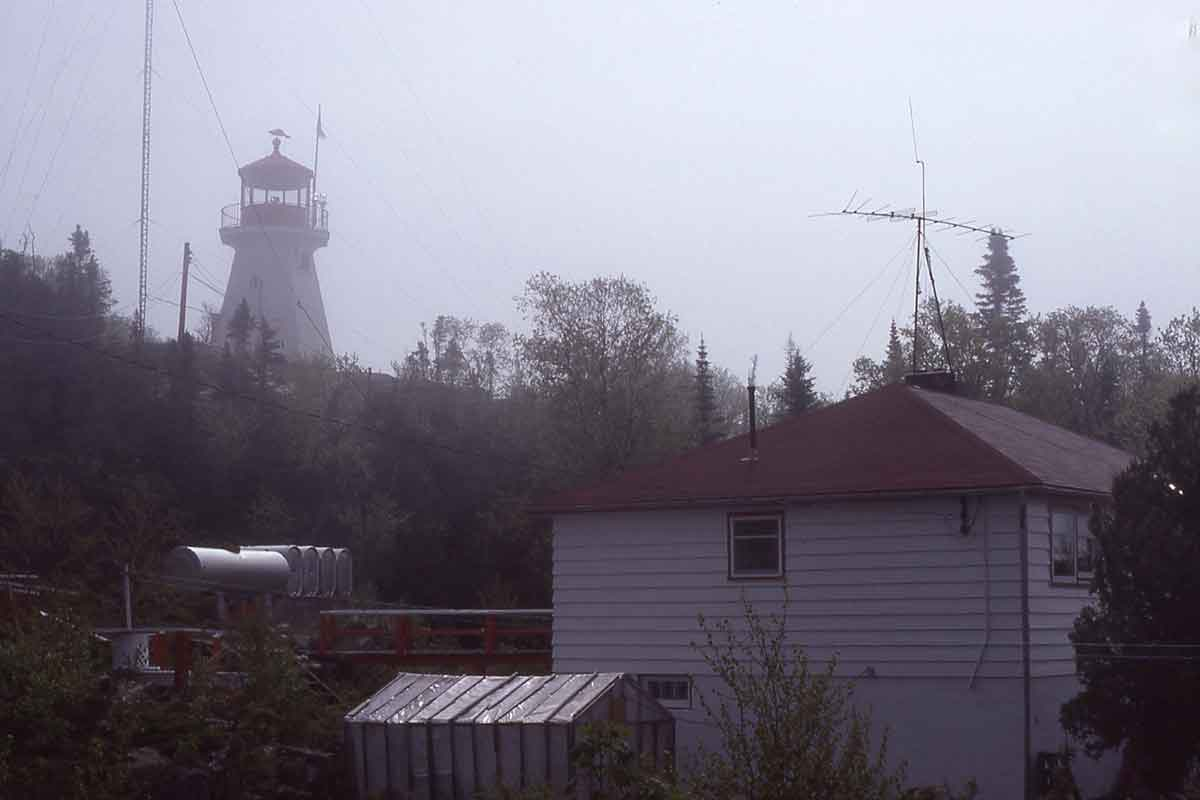 An historic boathouse and a two-story lighthouse keeper's home remain standing.