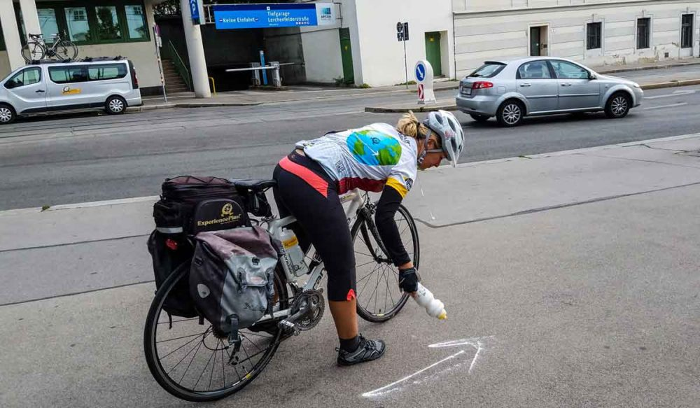 Chalk marks the way on an ExperiencePlus bike tour.