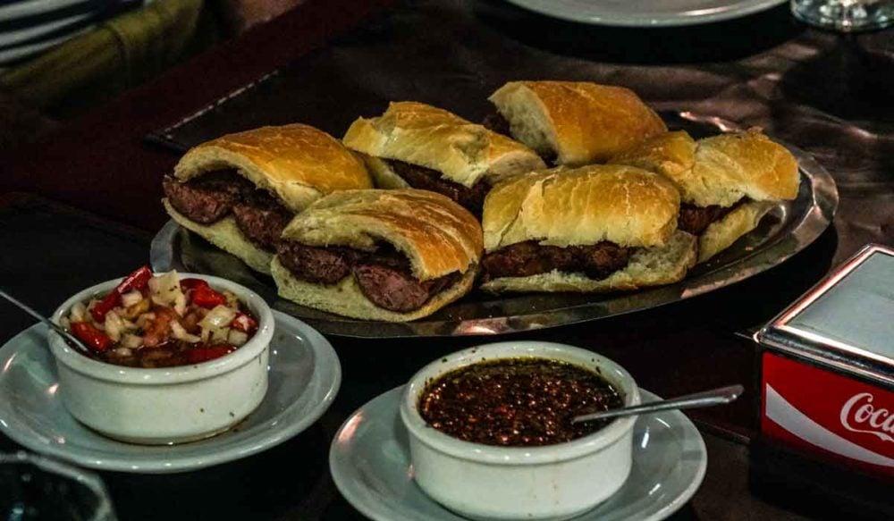 Parrilla food tour sausage sandwiches