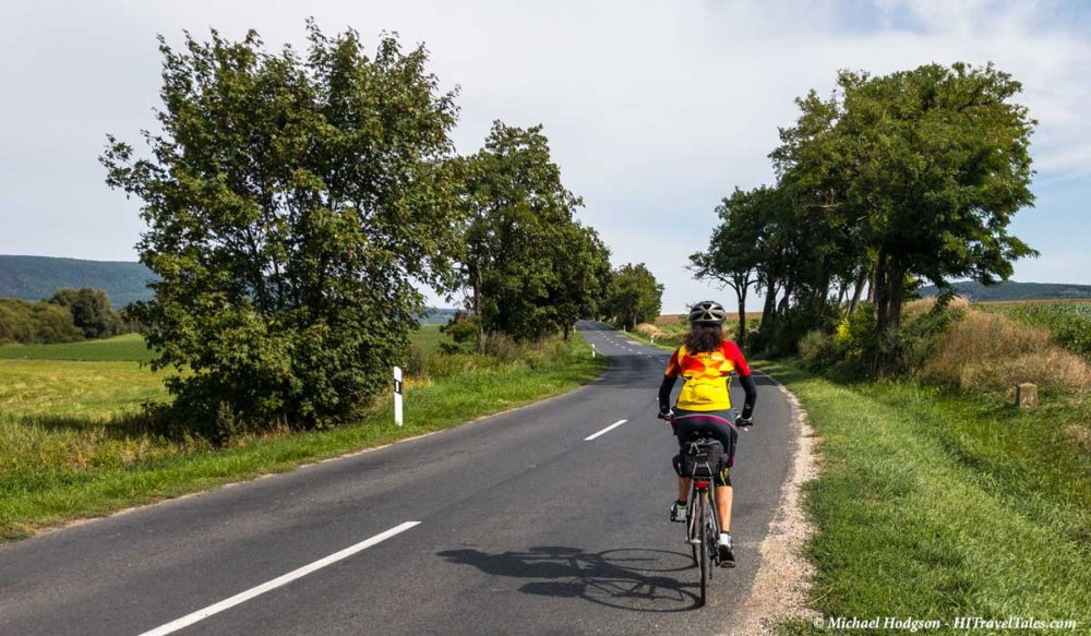 Therese enjoys the European roads on bike tour.
