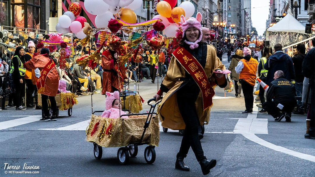 CNY Women Pulling Child In Cart Parade