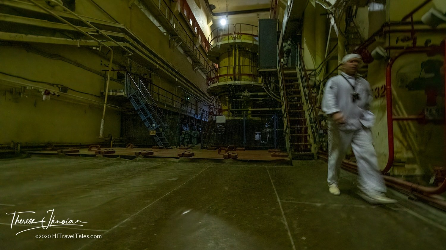 The Chernobyl plant remains staffed as it continues its slow decommissioning. The final unit of three reactors that did not explode was not shut down until 2000. Only Reactor 4 exploded. Here, a worker heads back to his station through a dark room of machinery.