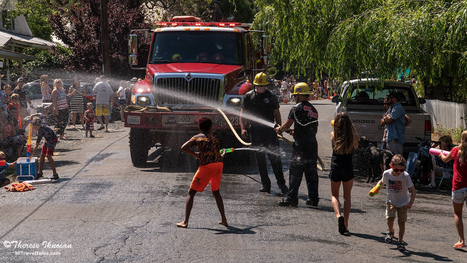 The fire fighters were dripping from their eyelashes and toes…and loving it.