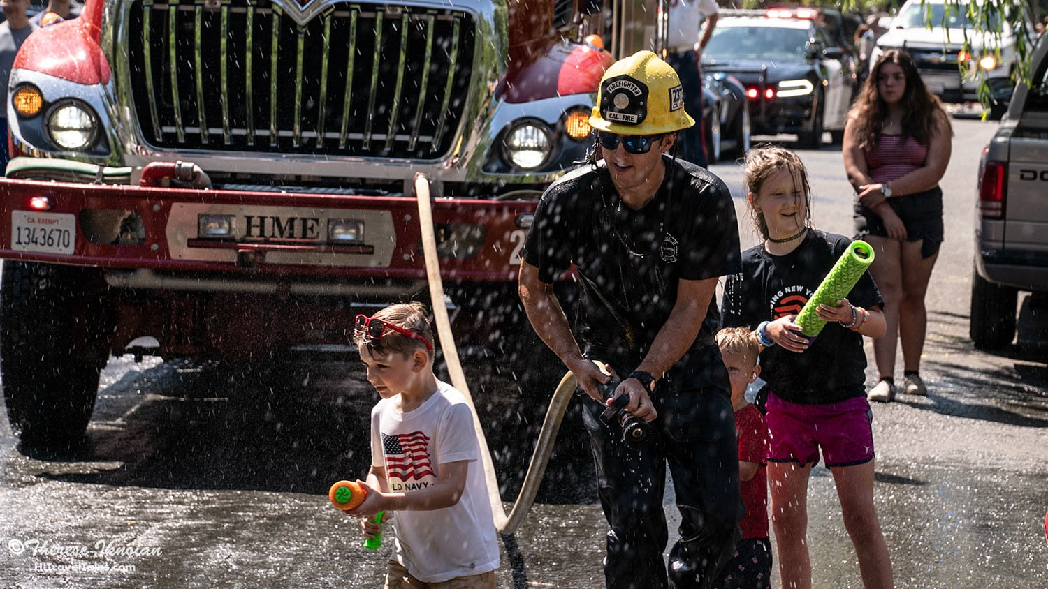 The little ones are treated well and even allowed to hold the fire hose sometimes.