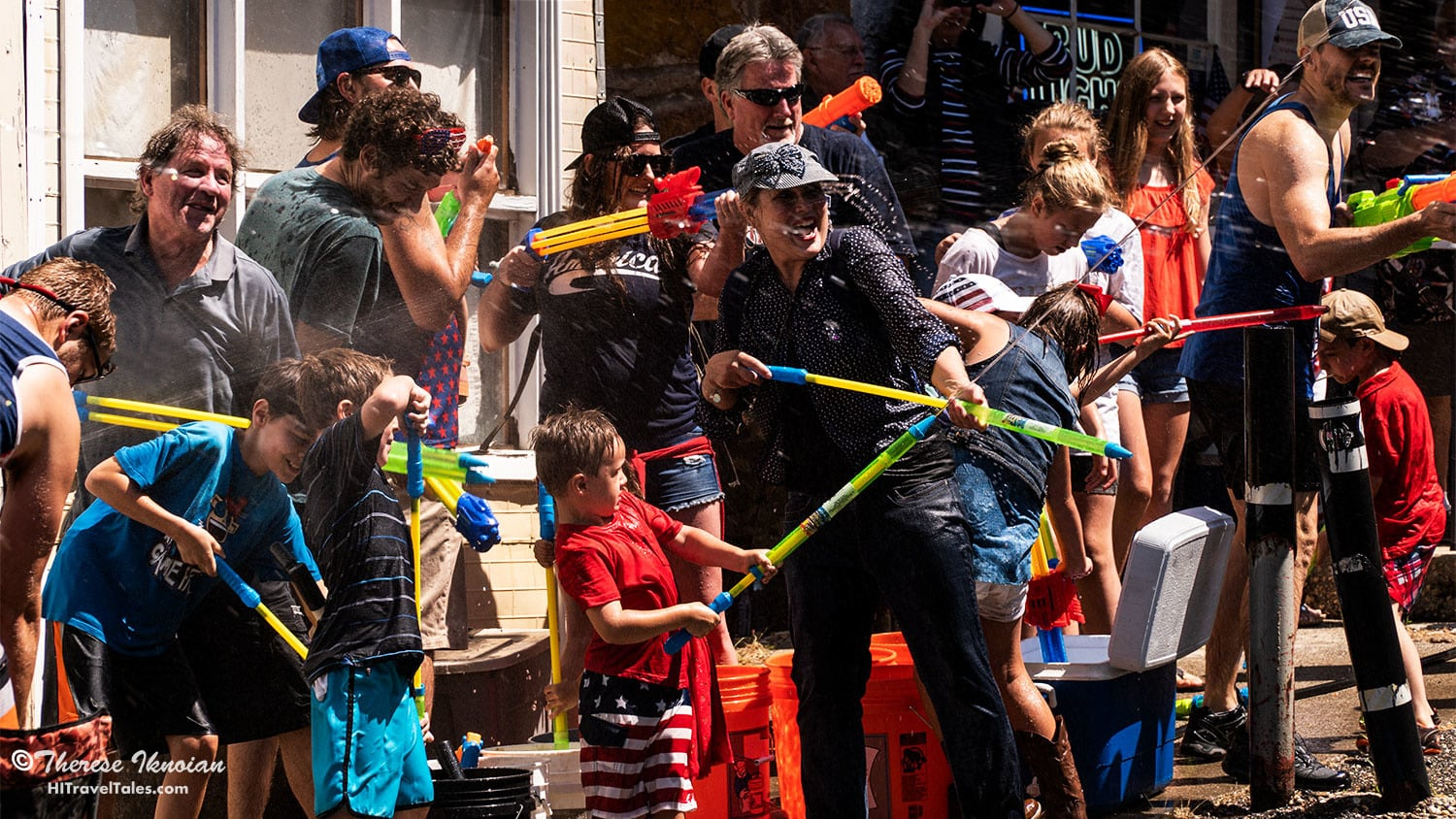 Between water fight battles at the Dutch Flat 4th of July parade, it's important to refill your weapons quickly.