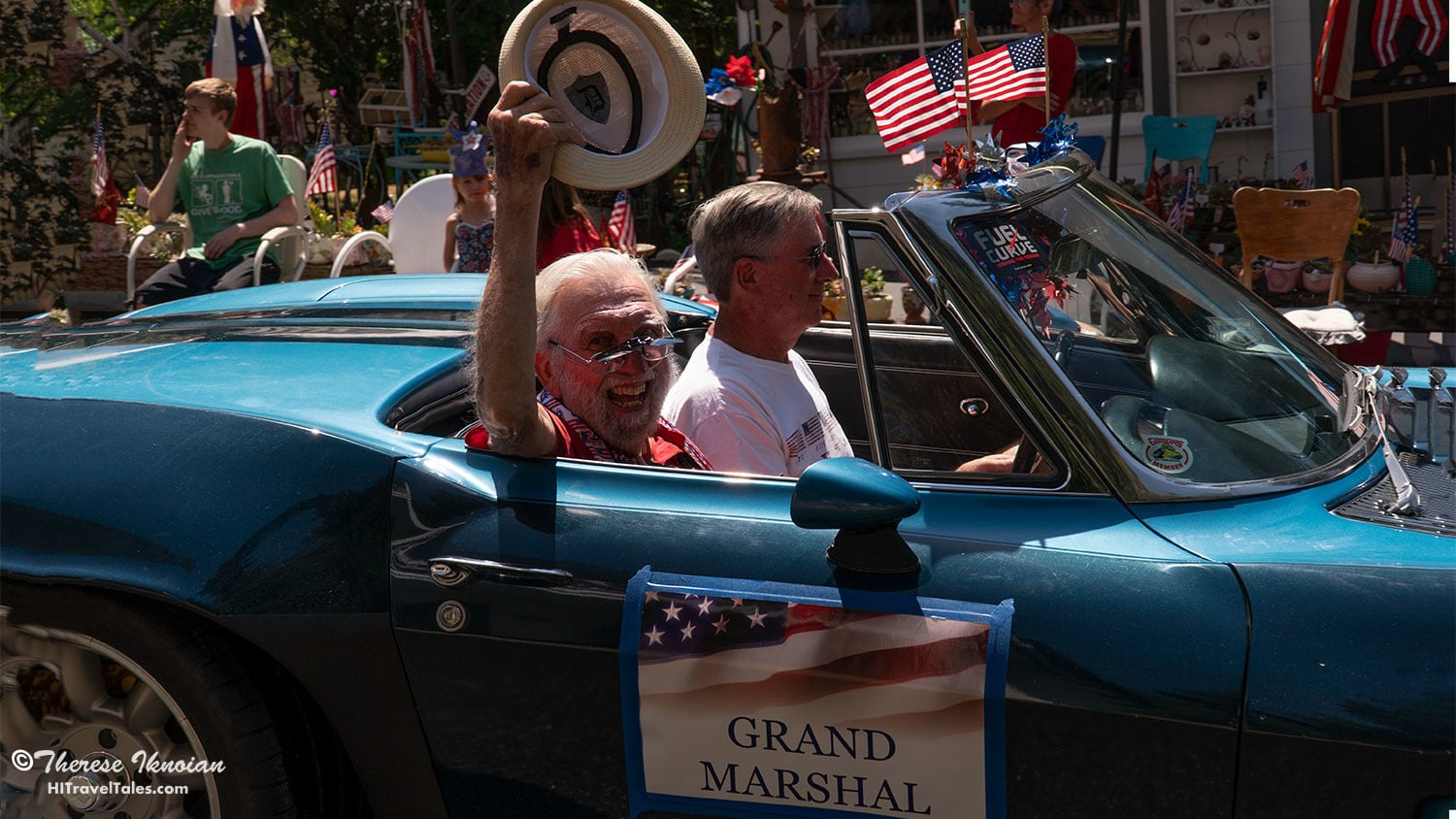The grand marshal waves his hat at everybody for two full loops through town (since one loop wouldn't be long enough).