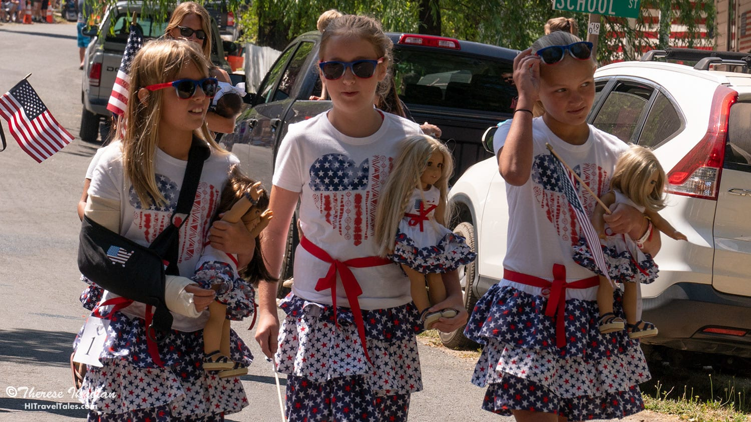 Everybody can march, as did these three friends decked out in red, white and blue with their American Girl dolls.