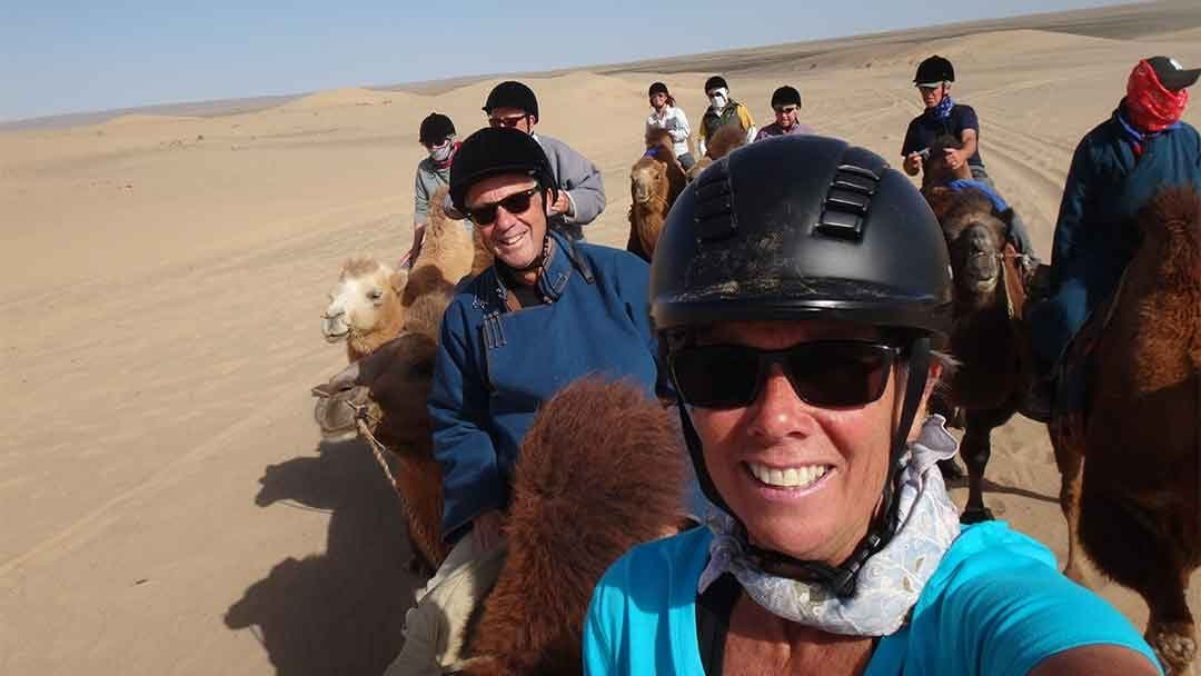 Katie Thomsen taking selfie in Gobi desert on a camel