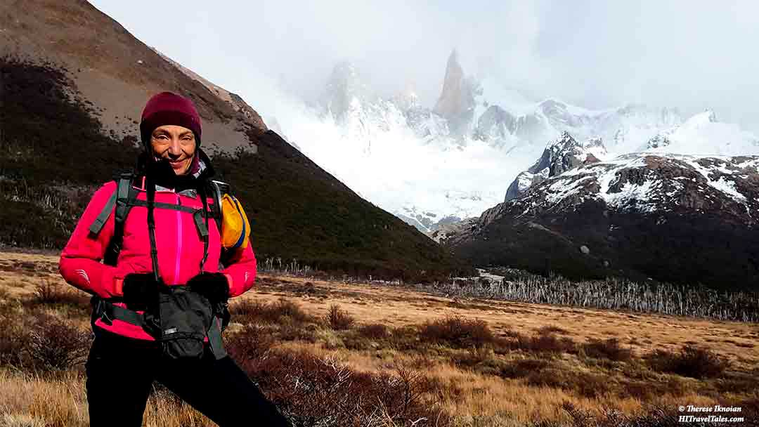 The author Therese Iknoian standing before Fitz Roy in Patagonia.