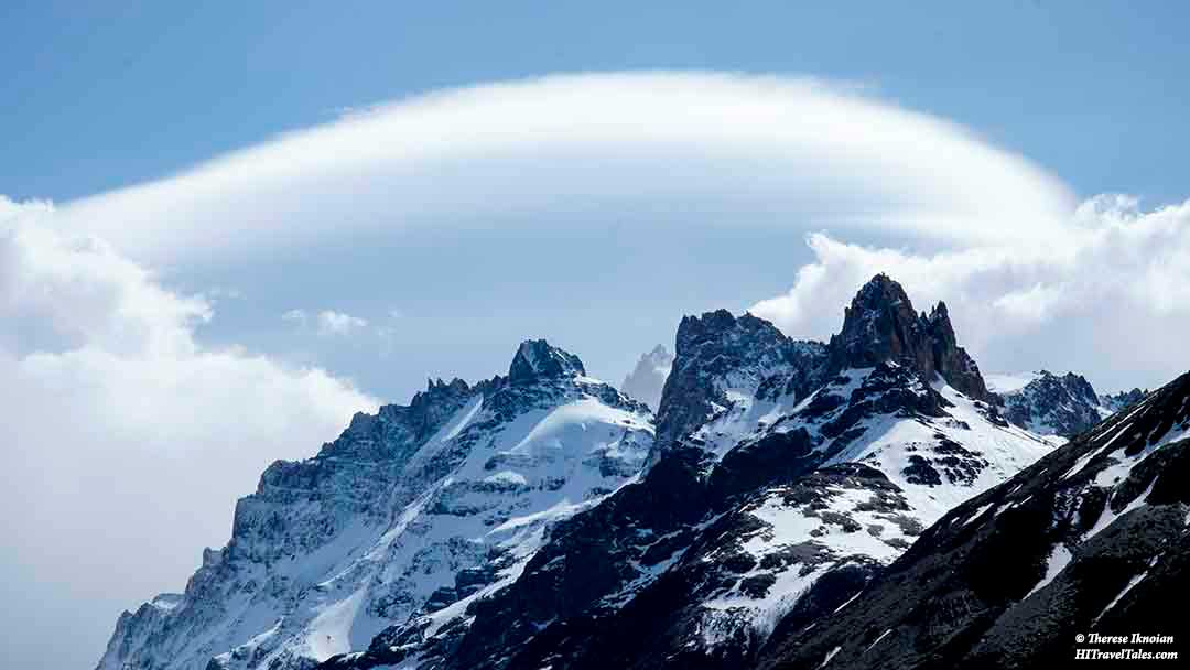 Cerro Torre catches the light in swirling clouds.