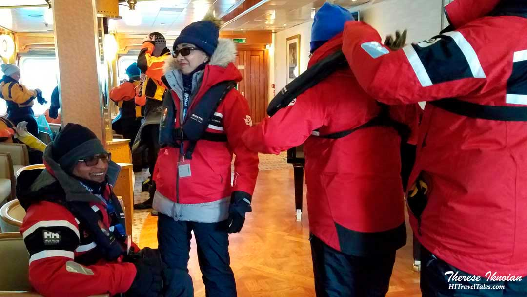 Passengers dressed and ready for a Zodiac cruise in Antarctica with Polar Latitudes.