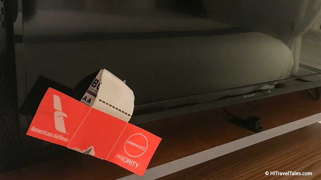 Luggage tag over tv led helps you sleep better in hotels