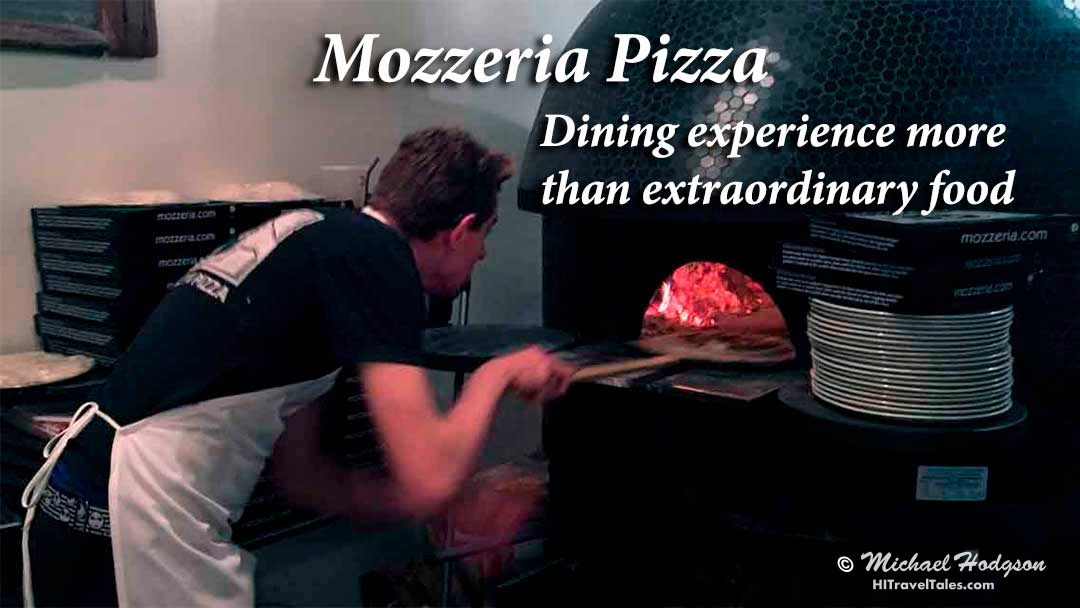 Chef puts pizza into oven at Mozzeria Pizzeria