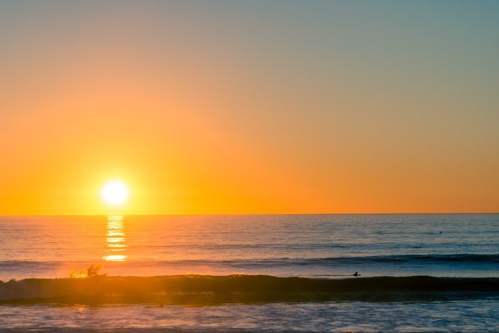 Surfer at sunset at Trestles in California